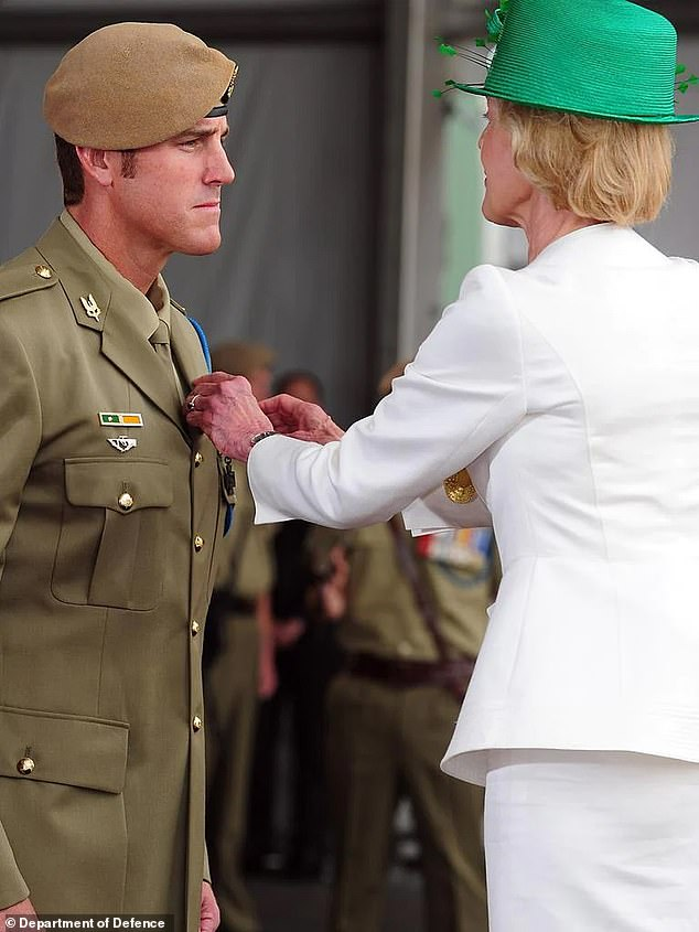 Former governor-general Dame Quentin Bryce pinned Mr Roberts-Smith's Victoria Cross to his chest (pictured) and was expected to give character evidence for him. She has said she will not be attending for personal reasons but has never withdrawn her support for the former soldier