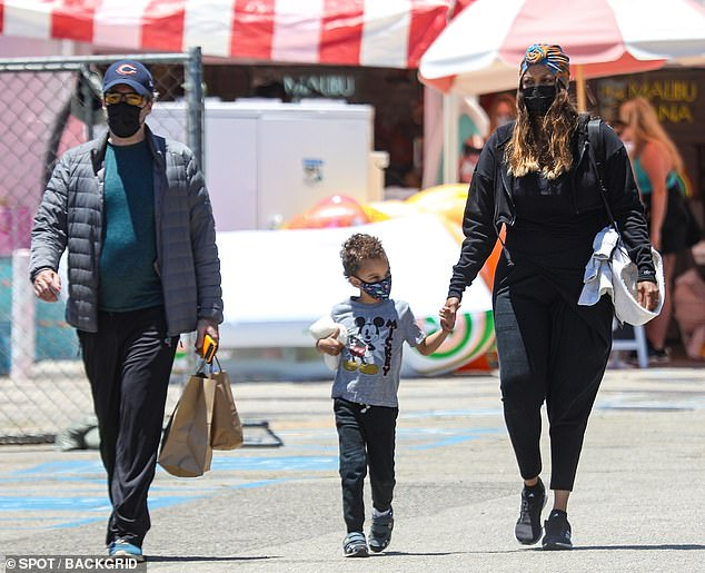 Party of three:She held hands with her son York, five, whom she shares with former partner Erik Asla