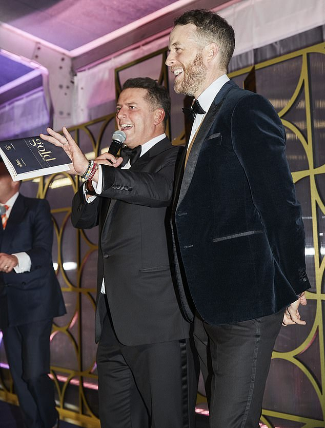 Man of the hour:The father of four, 46, was the emcee of the star-studded event, which raised funds for the Sydney Children's Hospitals Foundation. Pictured with Hamish Blake