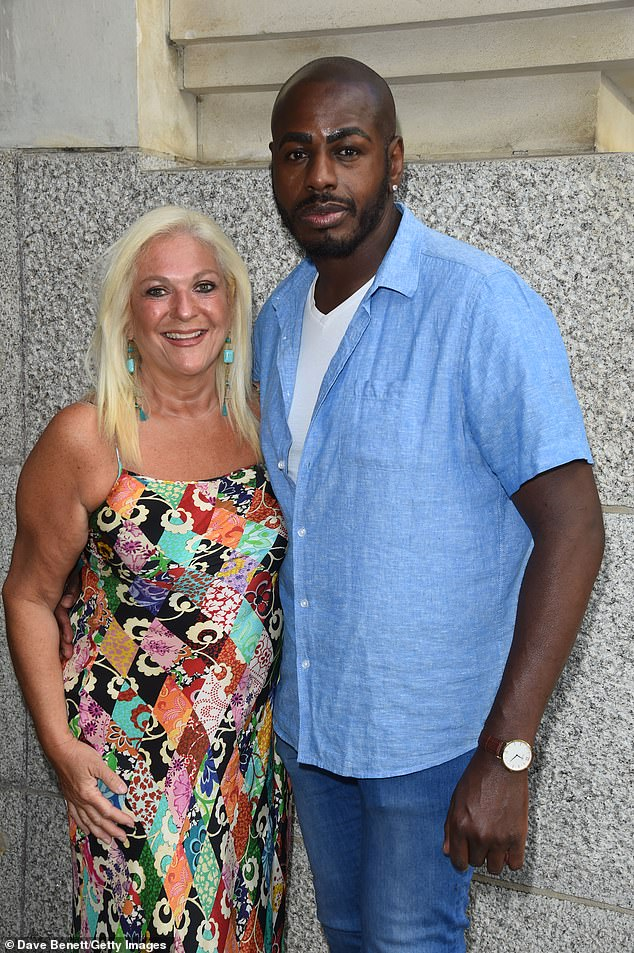 Loved-up:Her partner Ben Ofoedu lovingly wrapped his arm around her waist as he cut a laid-back figure in a denim shirt, shorts and a white tee