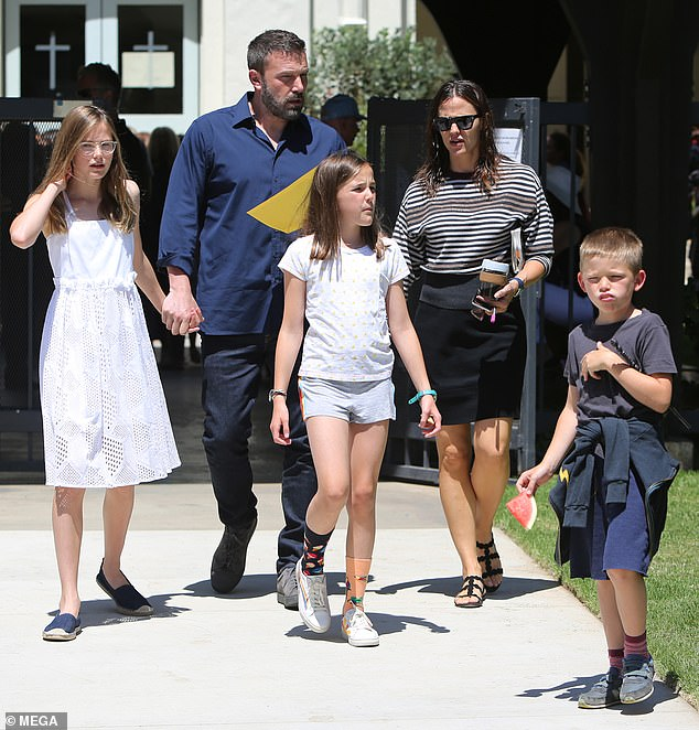 Daddy's Duty: Ben must stay in LA to be close to his three children, Violet, 15, Seraphina, 12, and Samuel, 9;  Ben pictured with his three children and Jennifer in 2019
