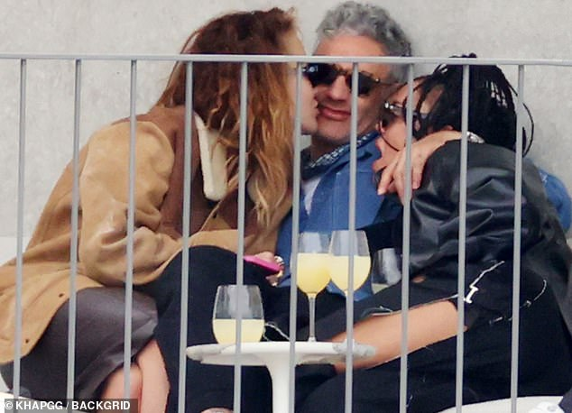 The moment: Last month, in photos taken exclusively by MailOnline, Taika, Rita and Tessa were all seen getting affectionate as they sit together over drinks outdoors