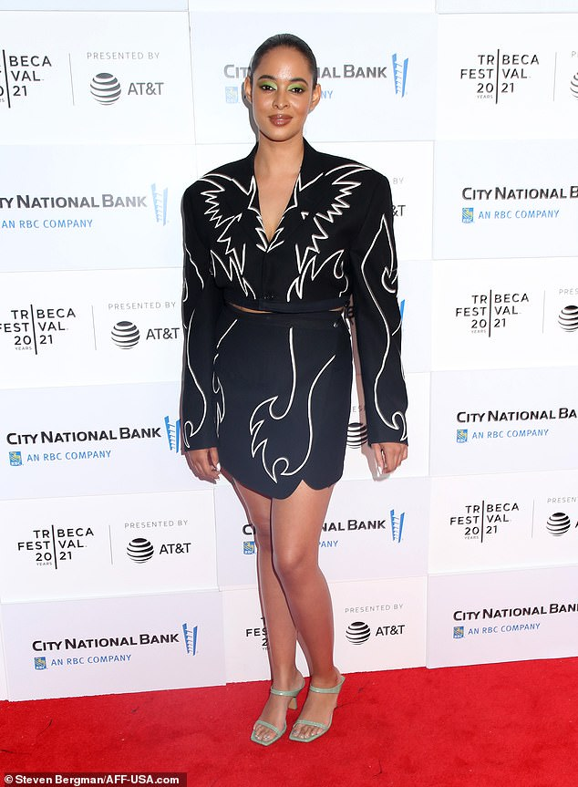 Helmer: Bailey wore an eye-catching black long-sleeve jacket and matching skirt that featured white swirly patterns and she added pale green sandal heels
