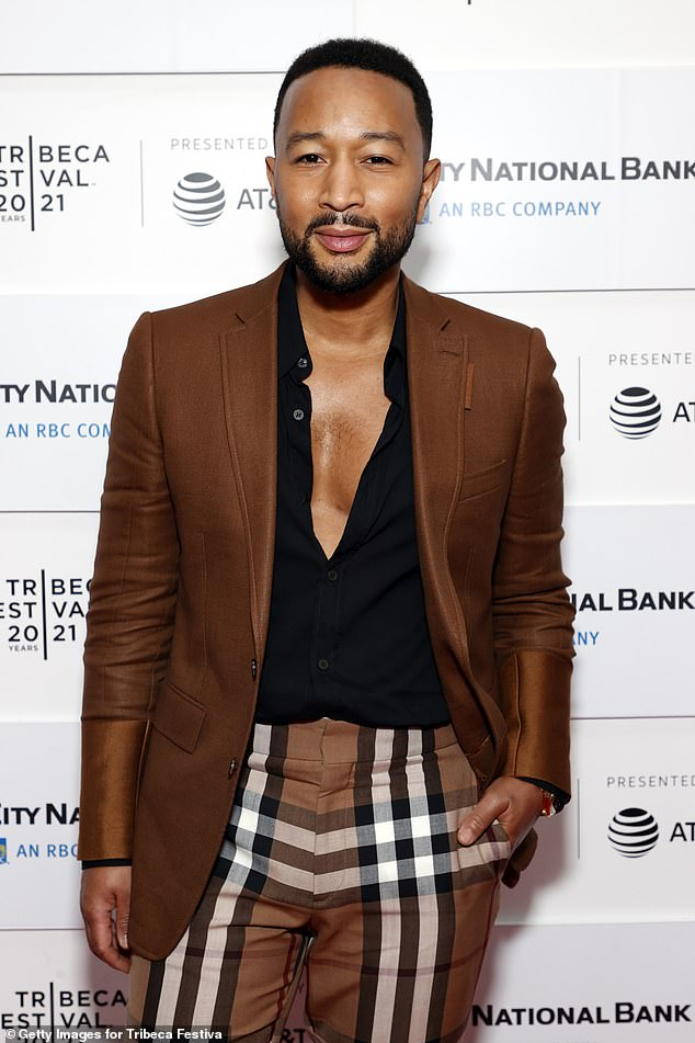 Looking good: The Grammy-winning recording artist left his shirt unbuttoned to flash a little chest hair and he sported a neatly trimmed full beard