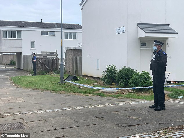 Pictures show investigations surrounding a house at the end of a residential road
