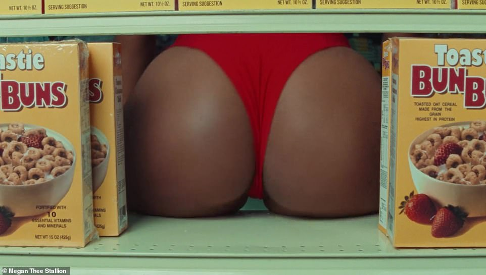 Surprise!After pulling a box of Toastie BunBuns off the shelf, he is shocked to see Megan's thong-clad bottom staring his straight in the face