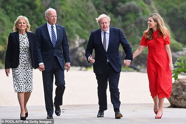 MIMICKING THE BIDENS' PDA: Judi said Carrie looked determined to give a 'confident' display with her new husband and held his hand tightly in a way that mimicked the Bidens