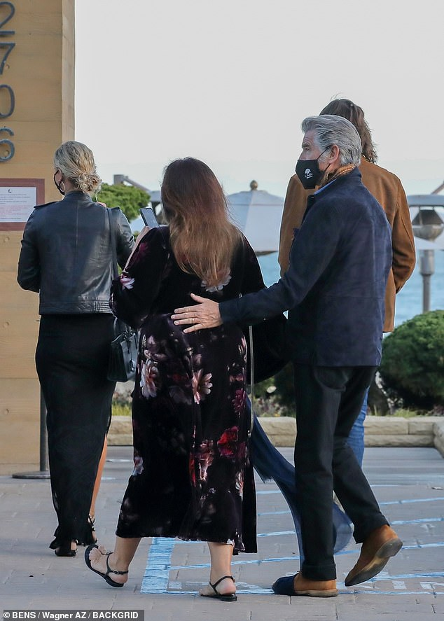 Dinner:Pierce Brosnan, 67, stepped out with his family for dinner in Malibu on Thursday and made sure to place a protective hand on his wife Keely Shaye's back