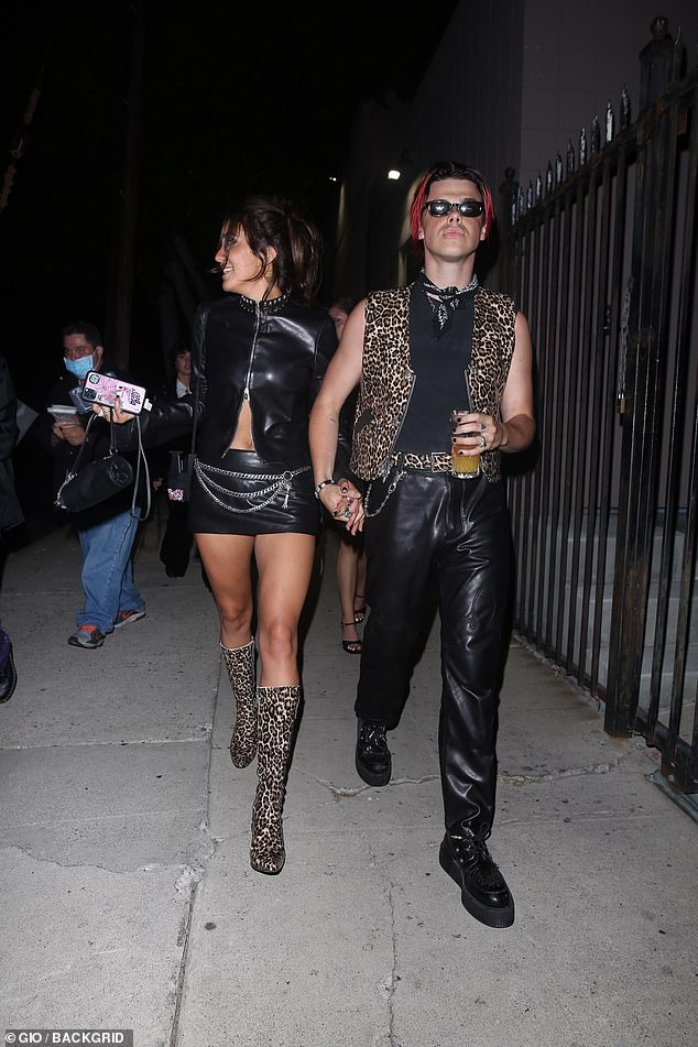 Loved: Yungblud, 23, made a statement in a leopard-print vest, while Jessie, 29, made your heart beat in a barely-there leather miniskirt