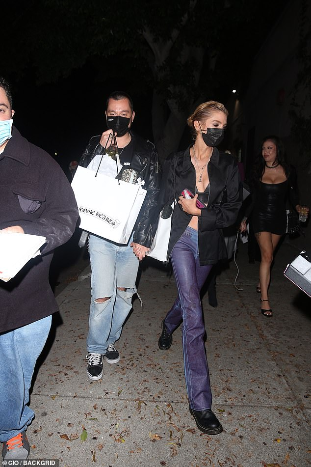 Hair Up: Stella wore her shiny blonde hair pulled back into a bun and protected her mouth and nose with a black face mask