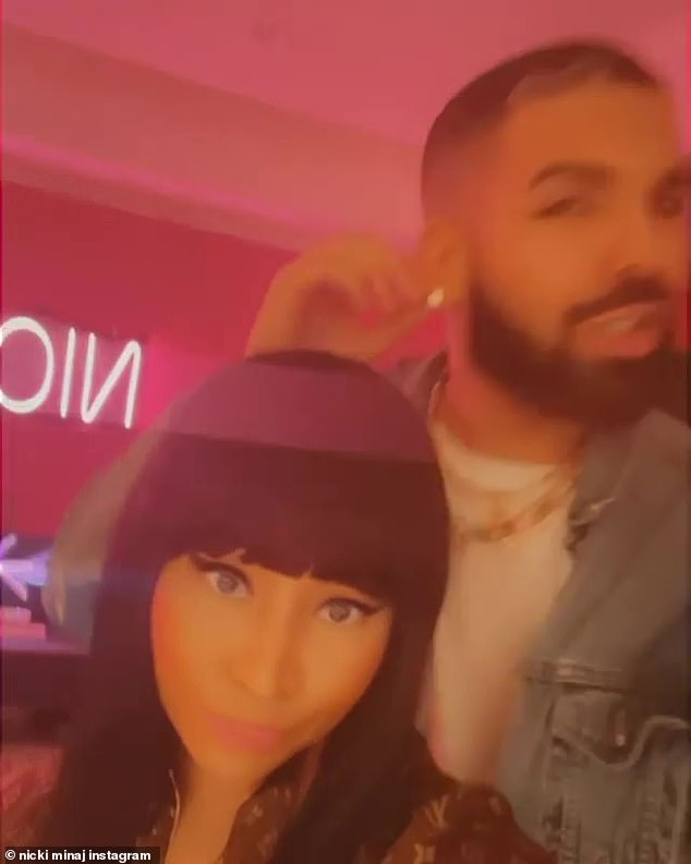 Knows his worth:Drake could be seen grinning as he taps his earlobes, ensuring video viewers can see his dazzling diamond earrings