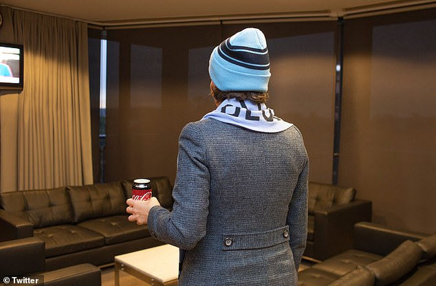 Original: The viral image, which has become a meme, shows premiere in a NSW Blues beanie and scarf, holding a can of Coke Zero while watching the game