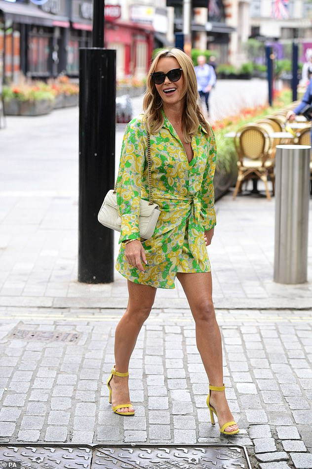 Strutting her stuff: The actress carried a white purse with a gold chain on her shoulder while wearing a pair of cat eye sunglasses and strappy yellow heels