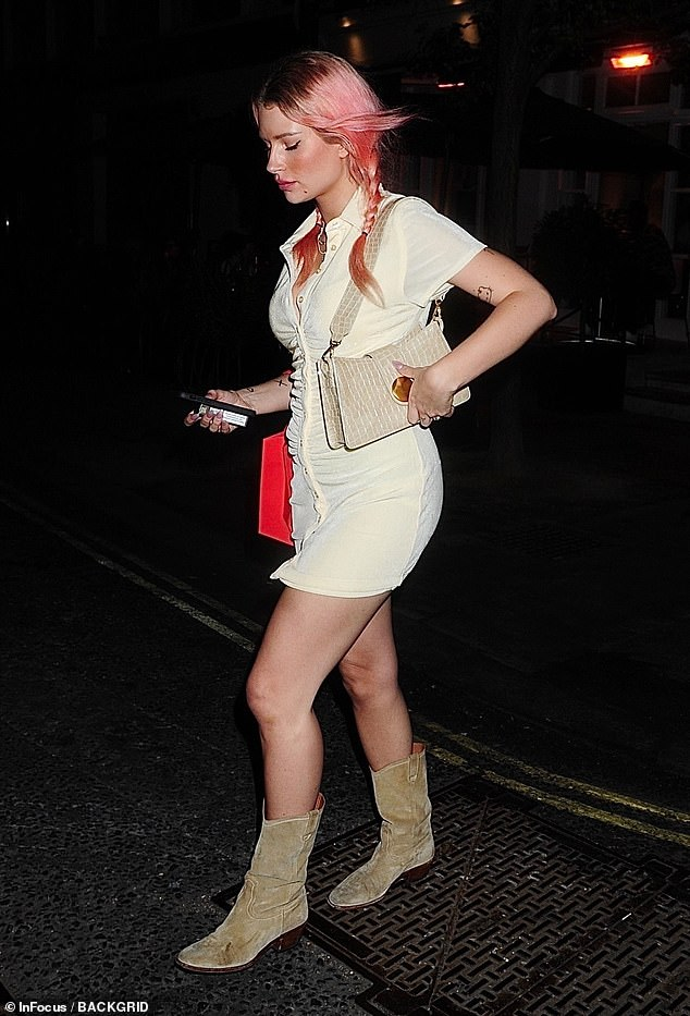 Stunning: The model, 23, rocked her pink hair in two braids for the night on the town