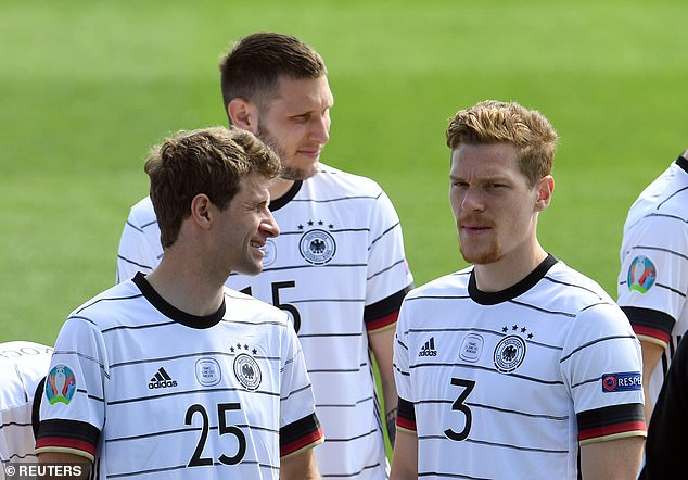 Bayern Munich's Thomas Muller (L) will be sharing a unit with Kevin Trapp and Robin Gosens