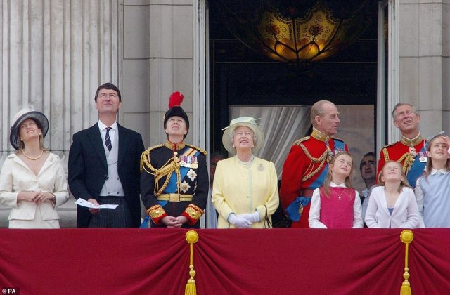 2004 — A SUNNY DAY:Members of the Royal Family watch the fly past from the balcony of Buckingham Palace during the Trooping the Colour ceremony along the Mall.