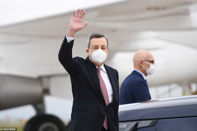 Italian PM Mario Draghi waved to waiting media as he arrived at the summit in Cornwall today