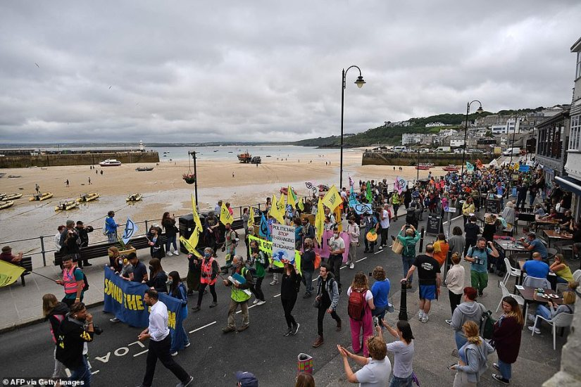 Up to 500 people are thought to have gathered for the protest in one of the most popular coastal towns