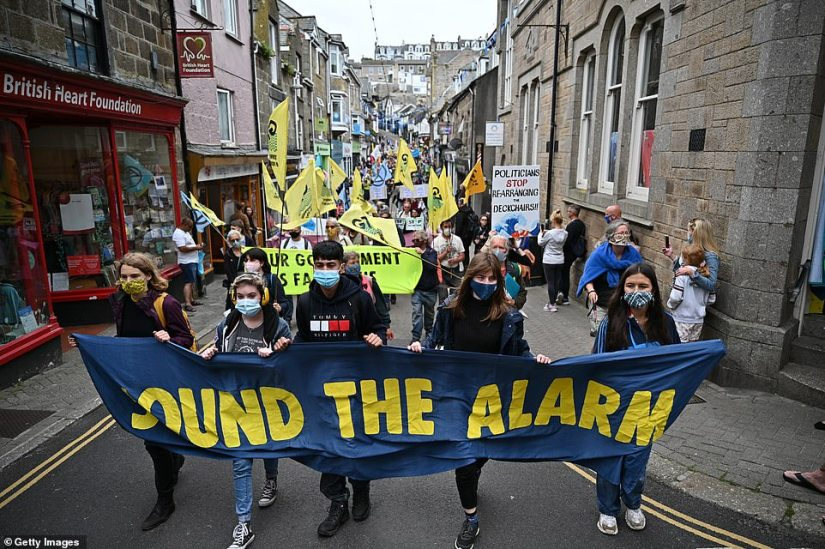 Yellow banners were waved in the air as bemused residents took a moment to record events in St Ives