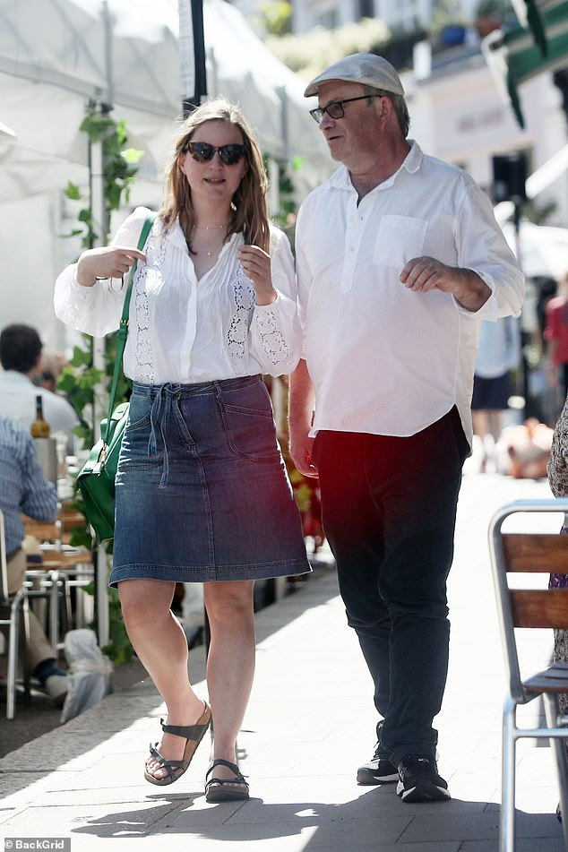 Close: Harry Enfield wouldn't let the split bring him down as he caught up with old friend comedian and co-star Catherine Shepherd in London on Friday