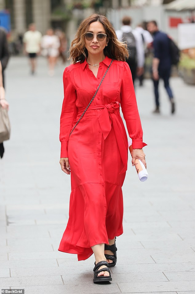 Chic: Myleene Klass looked radiant on Friday in a chic red dress as she made her way to Global Radio studios in London