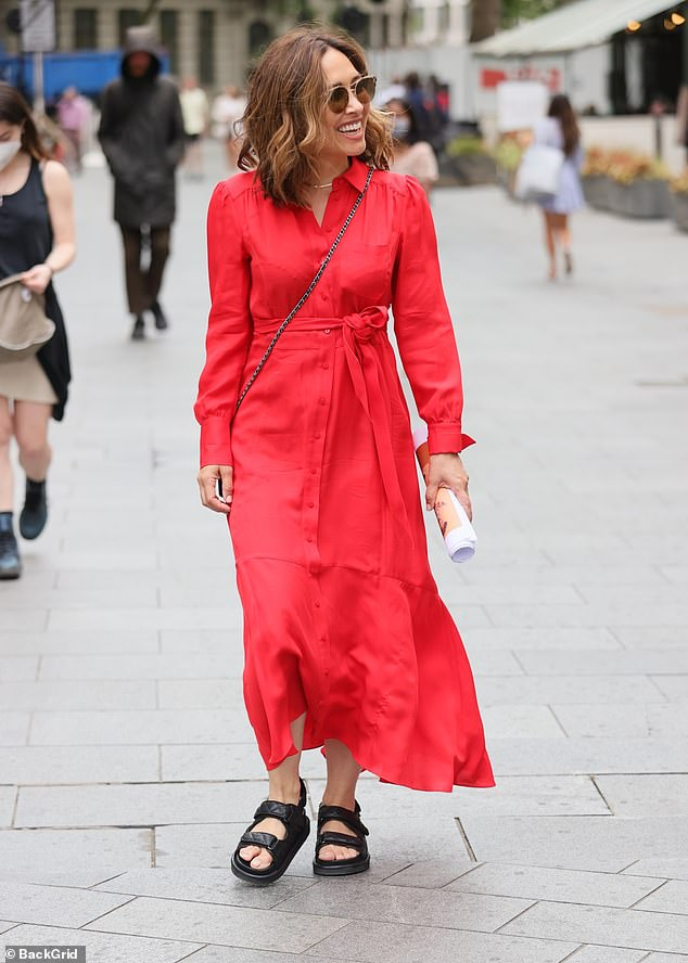 Style: The mother-of-three styled her brunette bob in loose waves and looked to be in great spirits as she entered the radio building