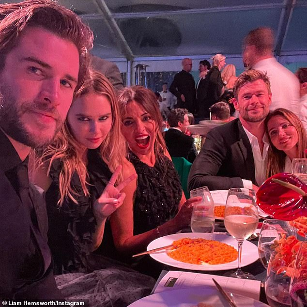 Star studded group: The actors (right) were joined at the event with Chris' younger brother Liam and his girlfriend Gabriella Brooks (left), and their friend Lucciana Barroso - the wife of actor Matt Damon (centre)