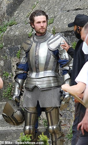 On set: Other characters on set included several men in elaborate silver armour