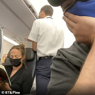 The unruly passenger is then seen arguing with the flight attendant. Eventually, the passenger appears to apologize for something