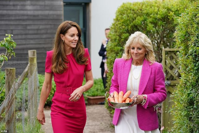 Meanwhile Dr Jill Biden matched the royal in a bold pink jacket fromLagence Fashion (pictured, during the school visit today)