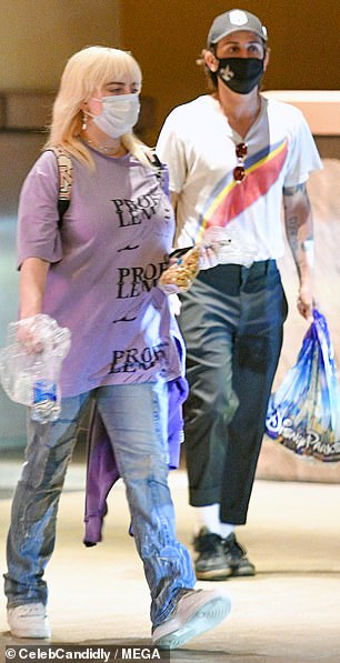 Bags of fun: The beloved couple were seen armed with treats after enjoying their day