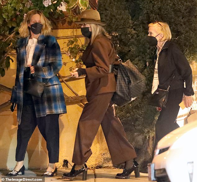 Party of three! Sarah Paulson enjoys a dinner outing with longtime partner Holland Taylor and their friend Diane Keaton in Beverly Hills on Thursday evening