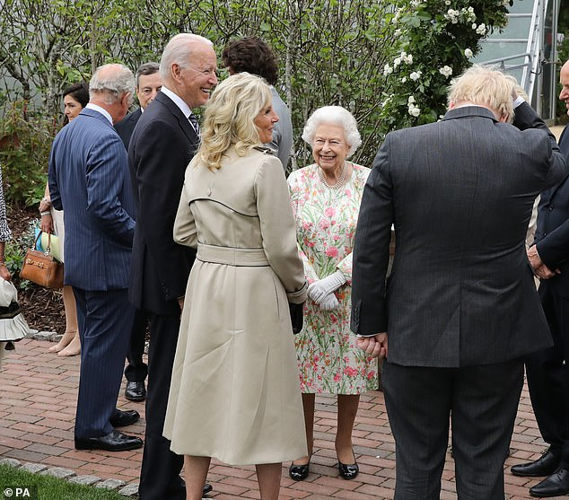 But it appears no grudges were held by the most senior members of the firm, as pictures showed the Queen beaming as she spoke to the president and his wife ahead of tonight's meal
