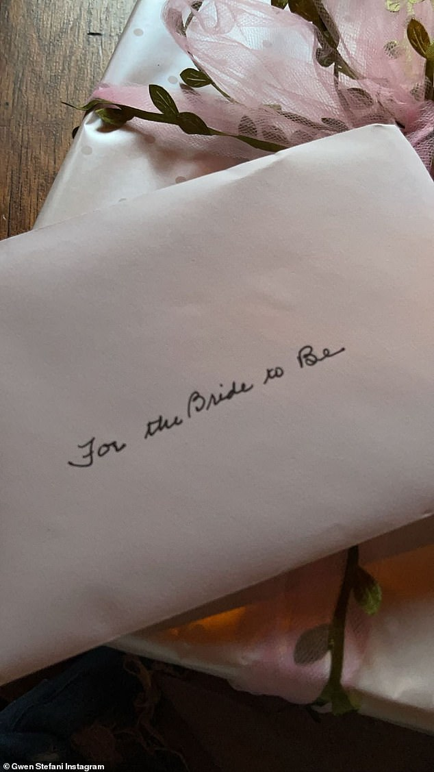Soon to be wed: In the next shot, a white card could be seen with black cursive lettering that read, 'For the Bride to Be'
