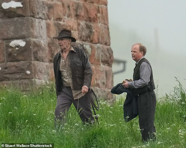 Production:Both actors cut a stern figure as stood amid tall grass while filming the new scenes