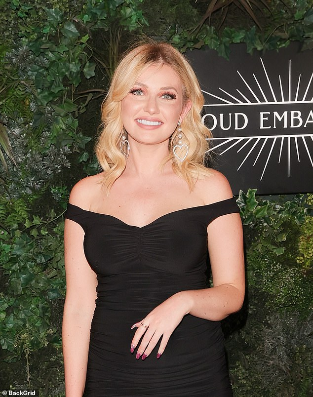 Happy:The blonde beauty looked radiant in the elegant midi dress as she headed to the show
