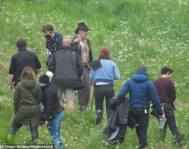 Production crew:In between scenes, crew donning face masks were seen milling around the actors