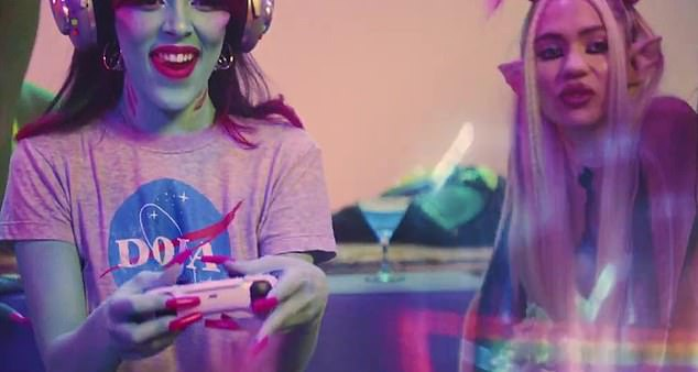 Dynamic duo:Grimes, 33, can be seen early in the music video as part of a group of girlfriends including Doja - all of whom are aliens on a foreign planet