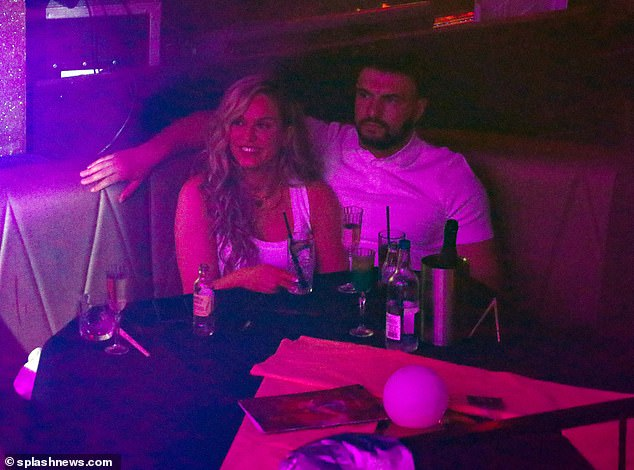 Having a ball:They appeared completely at ease with one another inside the Proud Embankment cabaret club, enjoying drinks and cheering on TV presenter Denise van Outen