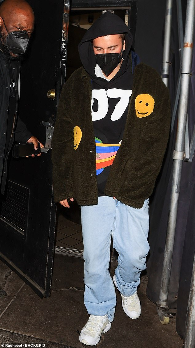 Night out: Justin Bieber, 27, kept a low profile in his signature baggy attire as he left The Nice Guy in West Hollywood on Friday