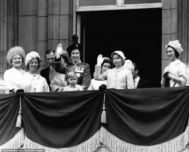 1962 — RESPLENDENT SMILES: A young Prince Andrew joins Queen Elizabeth to view the Trooping the Colour. Surrounding them, from left to right: The Queen Mother, The Duchess of Kent, The Duke of Kent, Princess Alexandra, Princess Anne and Princess Margaret.