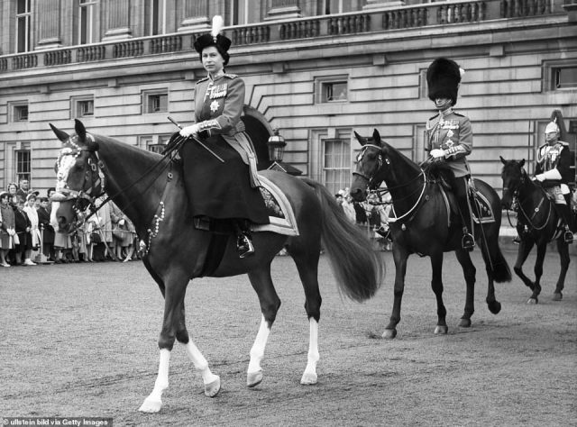 1960 — HER MAJESTY AND HER HORSE: Queen Elizabeth, on horseback, is again joined by Prince Philip to take in the Trooping the Colour.