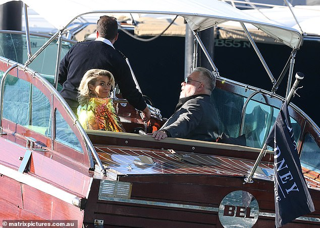 Ready to party! The couple took their seats on the speed boat as it whisked them to the superyacht