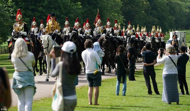 Members of the Household Cavalry make their way down the Long Walk towards Windsor Castle ahead of Saturday's ceremony