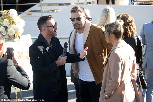 Getting content: Kyle and Jackie O producer Peter Deppler, also known as Intern Pete, was busy on the red carpet interviewing guests arriving.He spoke to former NRL star and guest presenter Beau Ryan who attended the party with his wife Kara