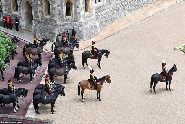 Windsor Castle was the setting for the spectacle dubbed a mini Trooping the Colour, featuring soldiers who have supported communities and the NHS during the pandemic or served overseas on military operations