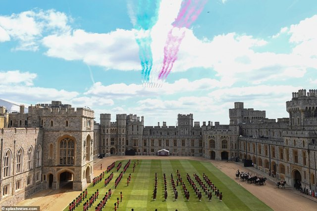 The Queen and Duke of Kent watch as Red Arrows fly over Windsor Castle at The Trooping Of The Colour