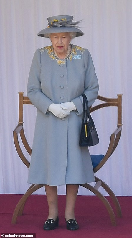 The Queen recycled a dove grey ensemble with yellow accents today for her official birthday celebrations at Windsor Castle in the traditional Trooping of the Colour ceremony