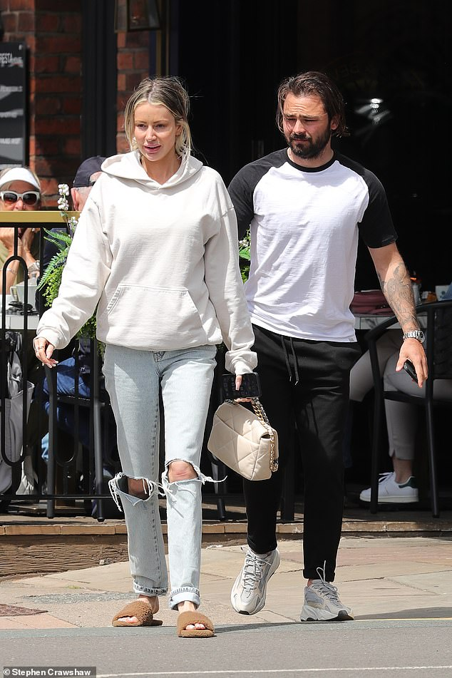 Lunch date:The loved-up couple were photographed leaving Juniper brassiere, with Love Island star Olivia looking typically trendy in ripped jeans teamed with a grey hoodie