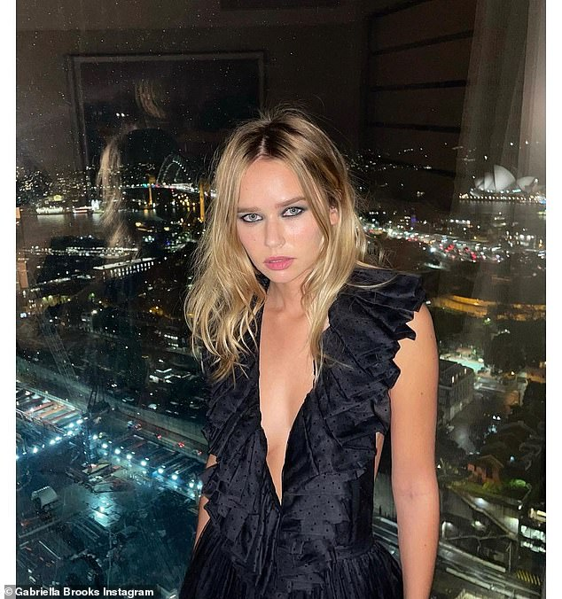 She wore Dior: Brooks also shared snaps from dinner where she showed off her Dior dress against the Sydney skyline